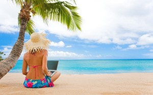 woman-on-the-beach-with-her-laptop-2771