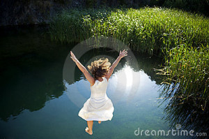 young-woman-jumping-water-11547098